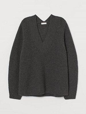 H&M Ribbstickad tröja i ullmix grå