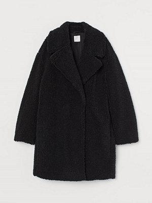 H&M Pilekappa svart
