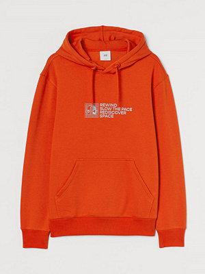 Street & luvtröjor - H&M Huvtröja med tryck orange