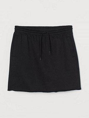 H&M Kort sweatshirtkjol svart