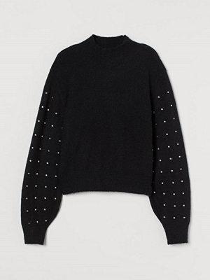 H&M Stickad tröja med strass svart