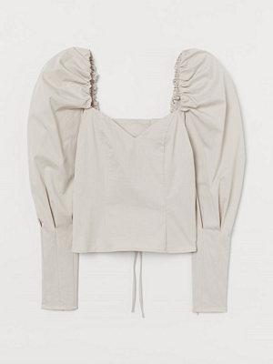 H&M Blus med snörning beige