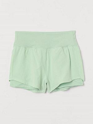 Shorts & kortbyxor - H&M Dubblerade träningsshorts grön