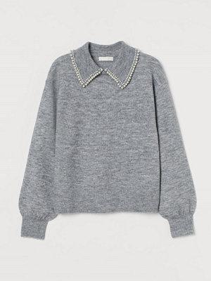 H&M Stickad tröja med krage grå