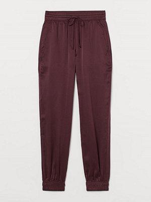 H&M omönstrade byxor Pull on-byxa i sidensatin rosa