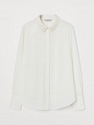 H&M Blus med pärlor vit