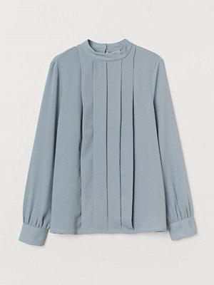 H&M Blus med lagda veck turkos