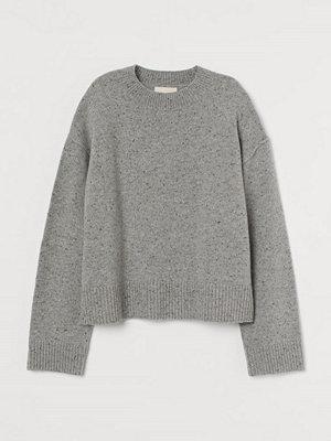 H&M Stickad tröja i ull grå