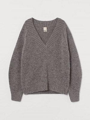 H&M Stickad tröja i ull brun