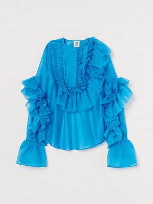 H&M Voluminös volangblus blå