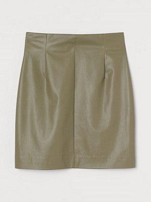 H&M Kjol i läderimitation grön
