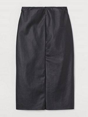 H&M Pennkjol i läderimitation svart