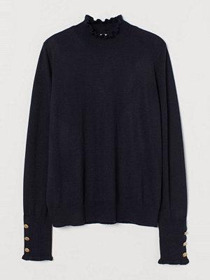 H&M Stickad tröja med halvpolo blå