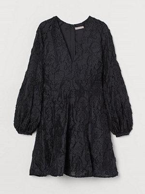 H&M Jacquardvävd klänning svart