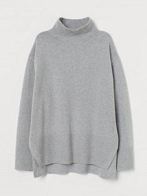 H&M Stickad polotröja grå