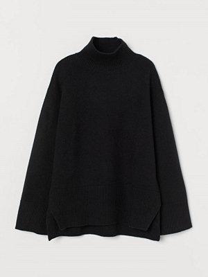 H&M Stickad polotröja svart