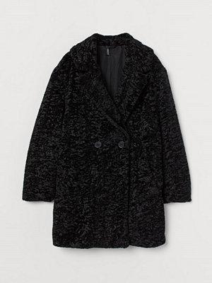 H&M Fuskpälskappa svart