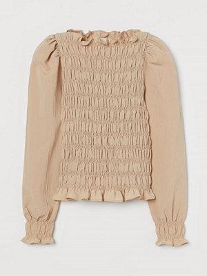 H&M Smockad blus med puffärm beige