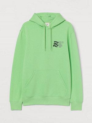 Street & luvtröjor - H&M Huvtröja med tryck grön