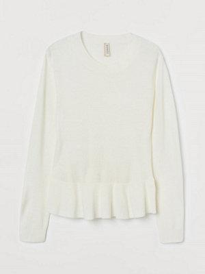 H&M Stickad tröja med peplum vit