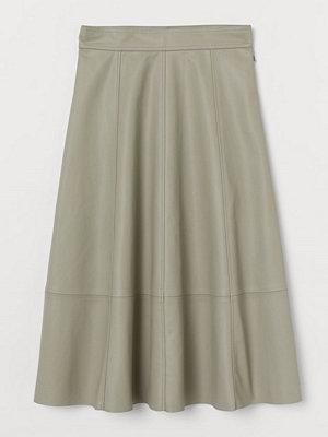 H&M Kjol i läderimitation gul