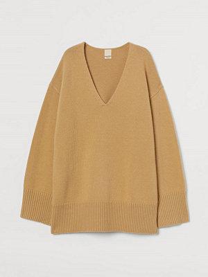 H&M Oversized tröja i ullmix gul