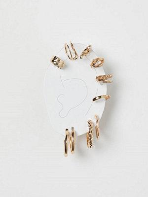 H&M 10-pack earcuffs och örhängen guld