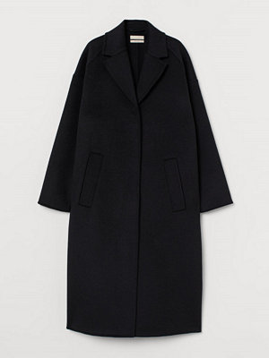 H&M Oversized kappa i ullmix svart