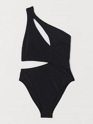 Baddräkter - H&M Cut out-baddräkt High leg svart