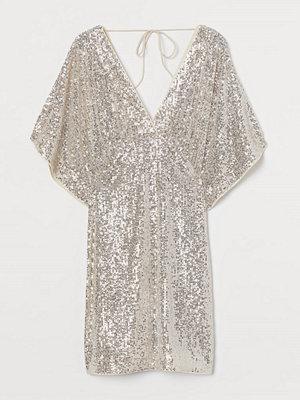 H&M Paljettklänning med vid ärm beige