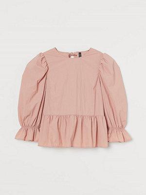 H&M Peplumblus med puffärm rosa