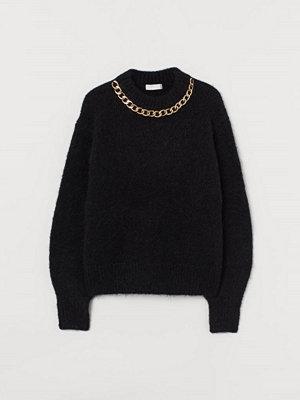 H&M Stickad tröja med kedja svart
