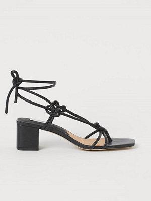 H&M Sandaletter i läder svart