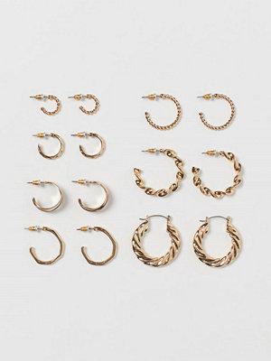 H&M 7 par runda örhängen guld