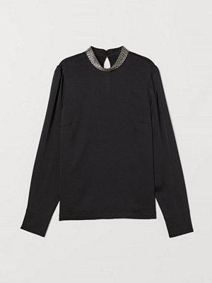 H&M Blus med applikation svart