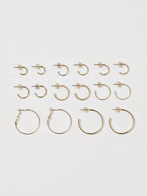 H&M 8 par örhängen guld
