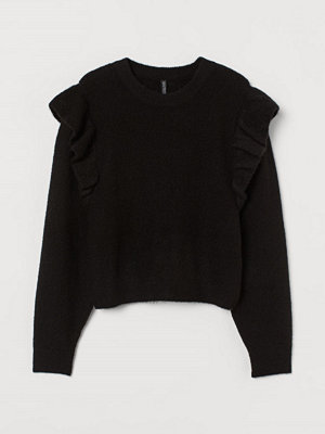 H&M Stickad tröja med volang svart