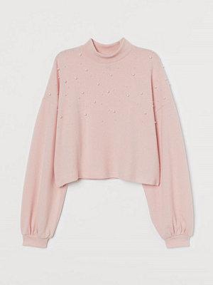H&M Stickad tröja med pärlor rosa