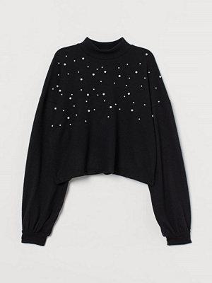 H&M Stickad tröja med pärlor svart