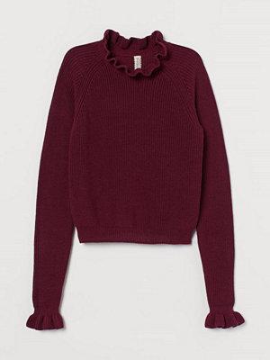 H&M Ribbstickad tröja med volang röd