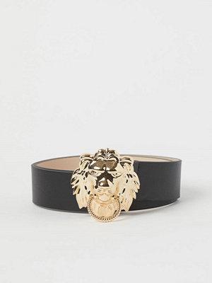 H&M Midjeskärp med lejon svart
