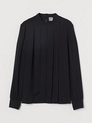 H&M Blus med lagda veck svart