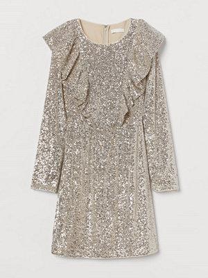 H&M Paljettklänning med volanger beige