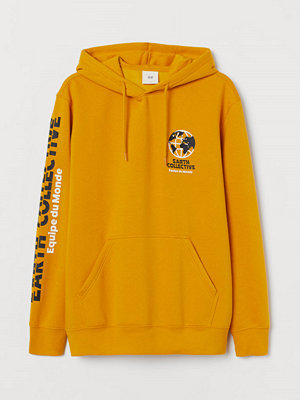 Street & luvtröjor - H&M Huvtröja med tryck gul