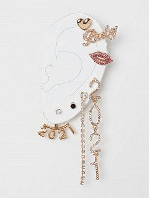H&M örhängen 7-pack studs med strass guld