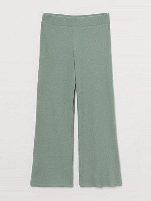 H&M omönstrade byxor Ribbad byxa grön