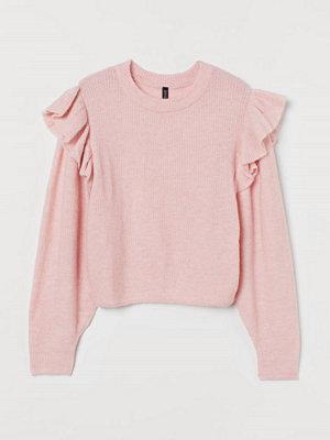 H&M Stickad tröja med volang rosa