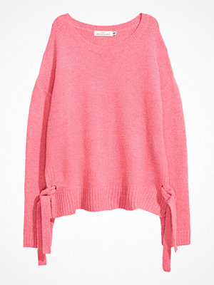 H&M Stickad tröja med knytband rosa