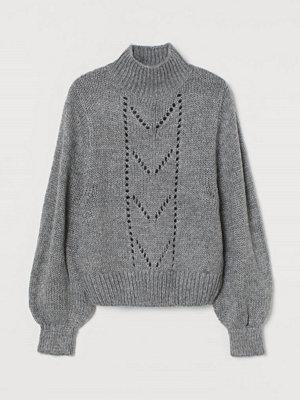 H&M Stickad tröja med pointelle grå