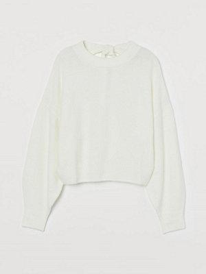 H&M Stickad tröja med knytband vit